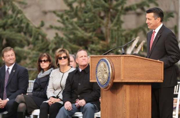 Sen. Dean Heller joined by his wife Lynne and Lt. Gov. Mark Hutchinson with his wife Cary listen to Gov. Brian Sandoval at Monday's inaugural ceremony.