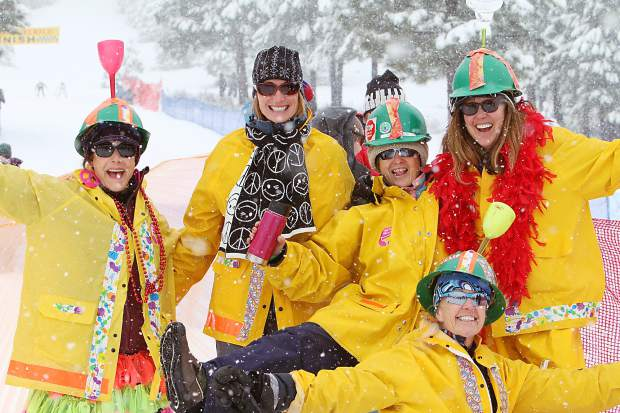 Great Ski Race cheerleaders keep the mood light at the finish-line party Sunday.