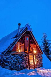 The Peter Grubb hut is an inviting sight at night.