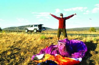 Stephan Haase, a Stateline resident, celebrates after breaking the Nevada distance paragliding record.