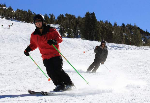 A pair of skiers enjoy near mid-season conditions on Heavenly Mountain Resorts slopes during opening day Saturday, Nov. 14.