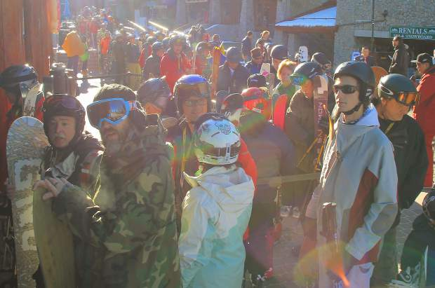 Skiers and snowboarders line up for the Heavenly Village gondola.