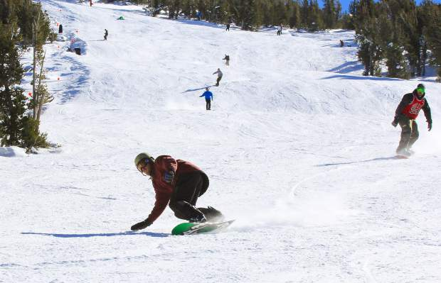 A snowboarder carves up one of Heavenly Mountain Resort's slopes on Saturday.