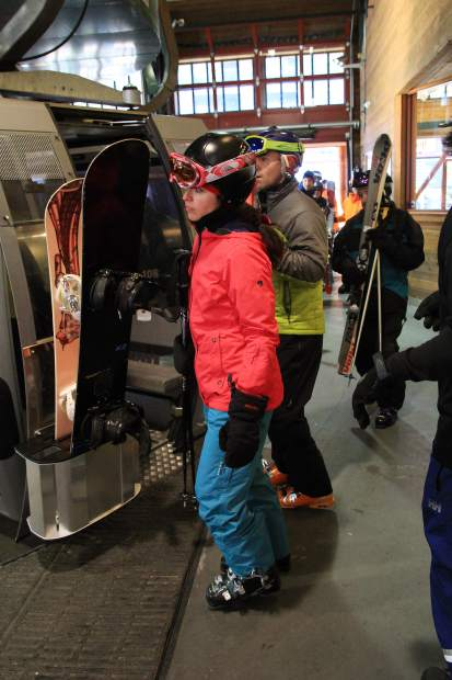 Snowboarders load a Heavenly Mountain Resort gondola during opening day 2015-16.