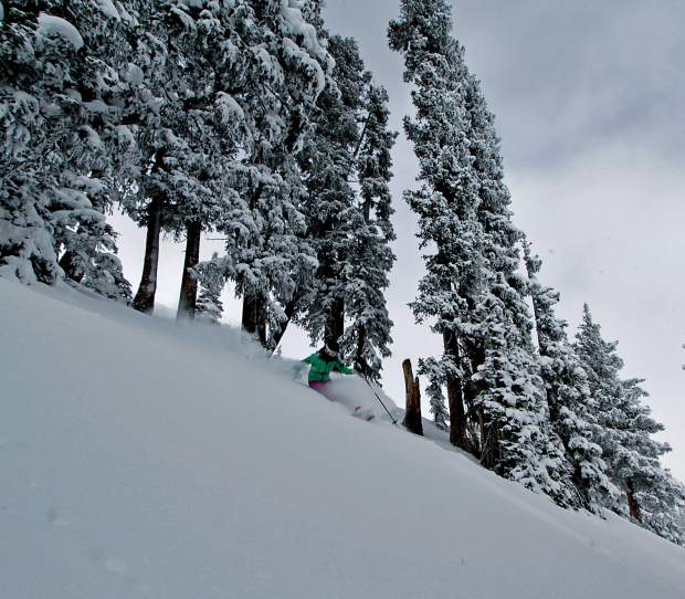 Greta Muxworthy charges through powder on the Liberty Envy skis at Aspen in mid-December.