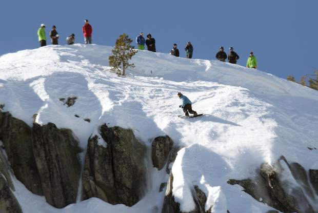 A snowboarder lines up for a cliff drop in Sierra-at-Tahoe's Huckleberry Canyon.