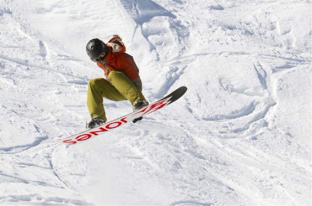 A snowboarder reaches for a grab during competition last weekend at Sierra-at-Tahoe.