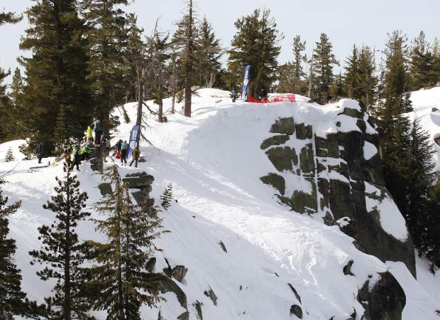 Skiers and snowboarders wait to drop in Huckleberry Canyon during big mountain competion at Sierra-at-Tahoe.
