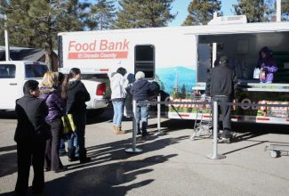 Food recipients wait in line at the Food Bank of El Dorado County's Mobile Food Pantry on Wednesday.