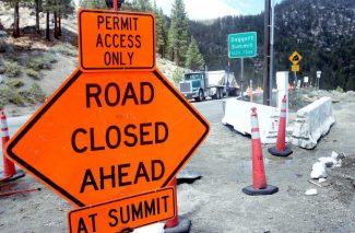 On Thursday, a sign on the corner of Tramway Drive and State Route 207 warns motorists of a road closure on Kingsbury Grade. Kingsbury will reopen Friday for through traffic during the summer months.