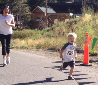 Three-year-old Kipton Walbrun ran his heart out to a cheering crowd at the finish line during the children's half-mile fun run at Kirkwood on Saturday.