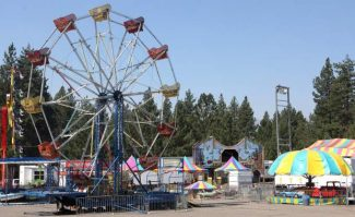 Rides for the Kiwanis Community Fair are set up Thursday afternoon in the parking lot of Heavenly Ski Resort.