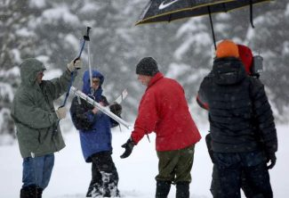 California Department of Water Resources snow surveyor Frank Gehrke, in the red jacket, measures the snowpack near Highway 50 and Sierra-At-Tahoe Road on Tuesday.