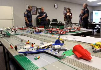 City and fire department officials with South Lake Tahoe stand behind a Lego model of Lake Tahoe Airport on Wednesday. The model will be used to help plan for the Mass Casualty Incident training on Aug. 25.