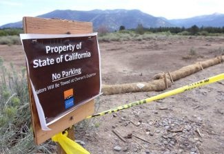 The Tahoe Keys Marina is being investigated for converting this California Tahoe Conservancy land into a dirt parking lot last week.