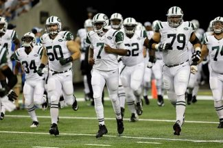 New York Jets outside linebacker Garrett McIntyre (50), quarterback Geno Smith (7) and  tackle J.B. Shugarts run onto the field in the first half of a preseason NFL football game against the Detroit Lions in Detroit, Friday.
