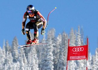 Canada's Erik Guay flies off the last jump during a men's World Cup downhill skiing training run Thursday, in Beaver Creek, Colo.