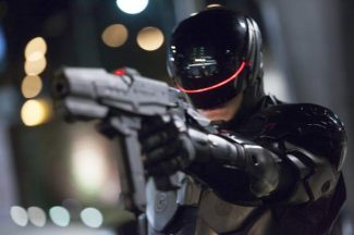 "This image released by Columbia Pictures shows Joel Kinnaman in a scene from ""RoboCop."""