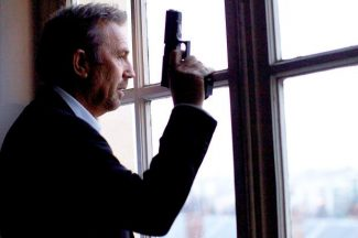 "This image released by Relativity Media shows Kevin Costner in a scene from ""3 Days to Kill."""