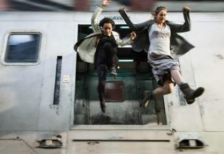 "This image released by Summit Entertainment shows Zoe Kravitz, left, and Shailene Woodley in a scene from ""Divergent."""