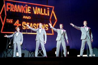 "This photo released by Warner Bros. Pictures shows, from left, John Lloyd Young as Frankie Valli, Erich Bergen as Bob Gaudio, Vincent Piazza as Tommy DeVito and Michael Lomenda as Nick Massi in the musical ""Jersey Boys."""