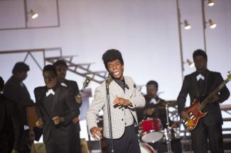"This image released by Universal Pictures shows Chadwick Boseman in a scene from ""Get On Up."""