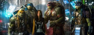 """This image released by Paramount Pictures shows, from left, Michelangelo, Leonardo, Megan Fox, as April O'Neil, Raphael, and Donatello in a scene from """"Teenage Mutant Ninja Turtles."""""""