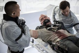 """This publicity image released by TriStar, Columbia Pictures-Sony shows Matt Damon, center, in a scene from """"Elysium."""""""
