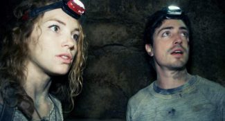 "This image released by Universal Pictures shows Perdita Weeks, left, and Ben Feldman in a scene from the film, ""As Above, So Below."""
