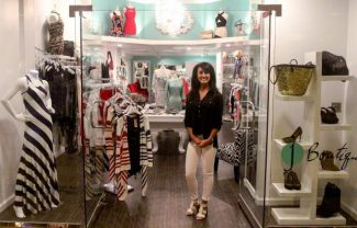 Julie Mitchell stands in the entrance of her new store, j Boutique, located inside Harrah's Lake Tahoe.