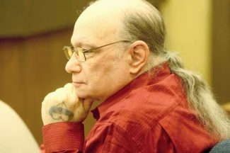 Joseph Nissensohn sits at the defense table in early October before trial.