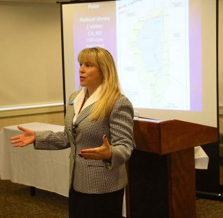 Julie Regan, chief of external affairs at Tahoe Regional Planning Agency, speaks at Lake Tahoe Resort Hotel for Operation Sierra Storm on Thursday.