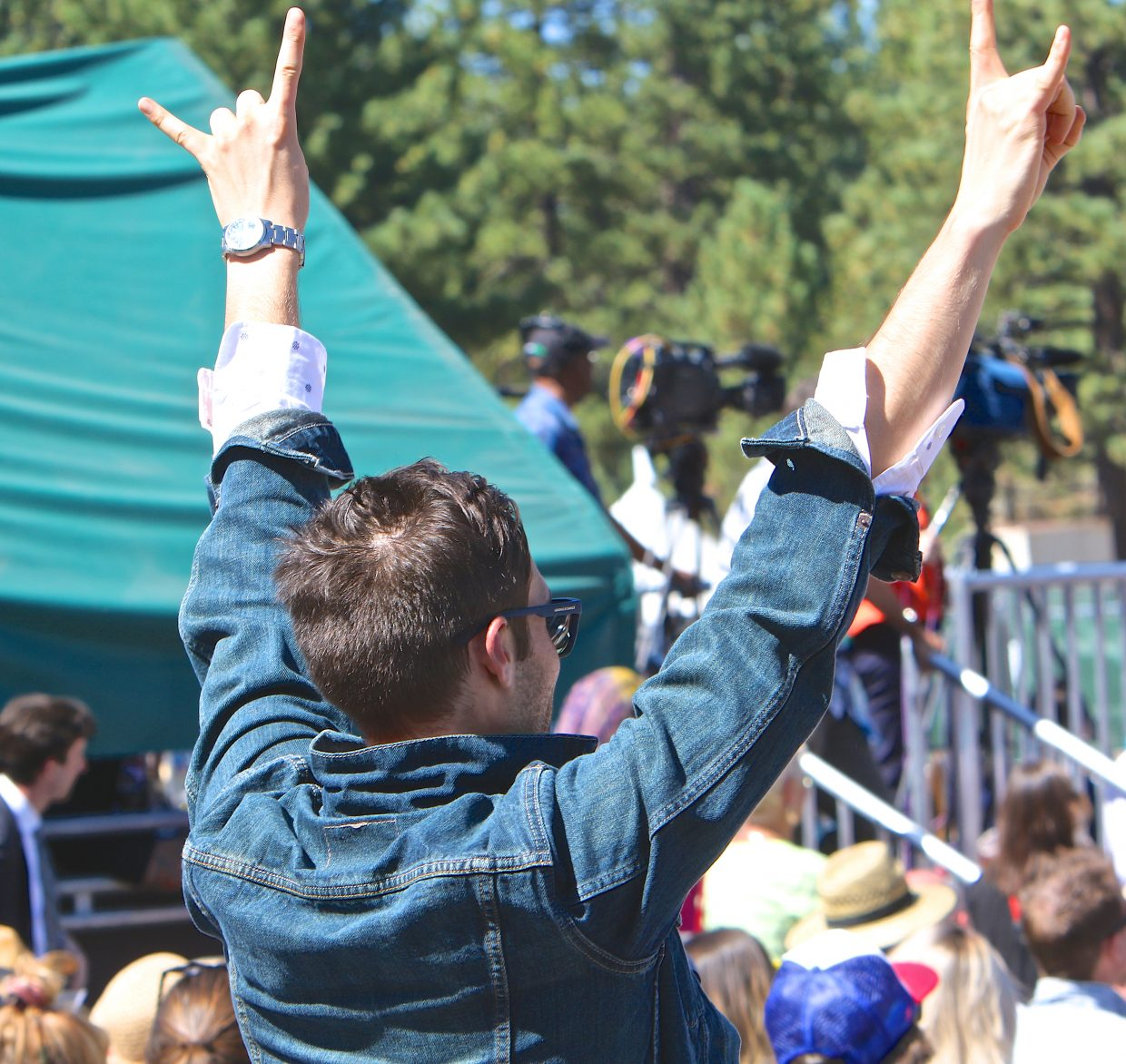 A supporter of the president raises his hands in the air Wednesday at Harvey's Outdoor Amphitheater.
