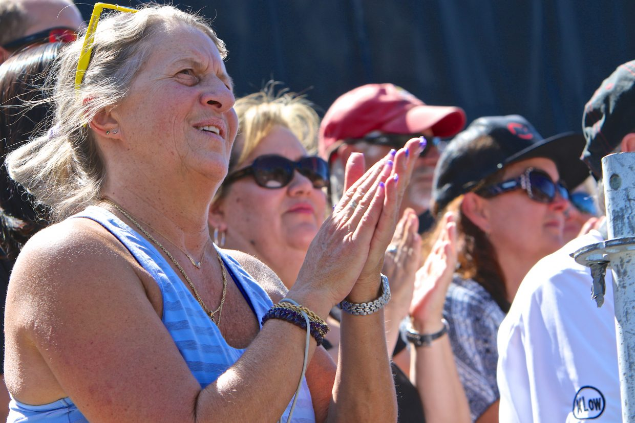A woman claps in support of President Obama's statements at the Lake Tahoe Summit Wednesday.