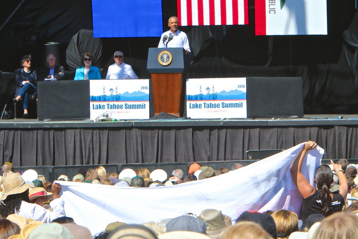President Obama's speech is briefly interrupted by protestors holding up a banner and yelling Wednesday at the 20th Annual Lake Tahoe Summit in Stateline.