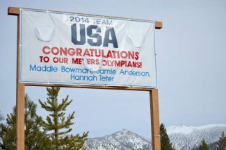 A sign in front of Meyers Downtown Cafe shows support for three local Olympians.