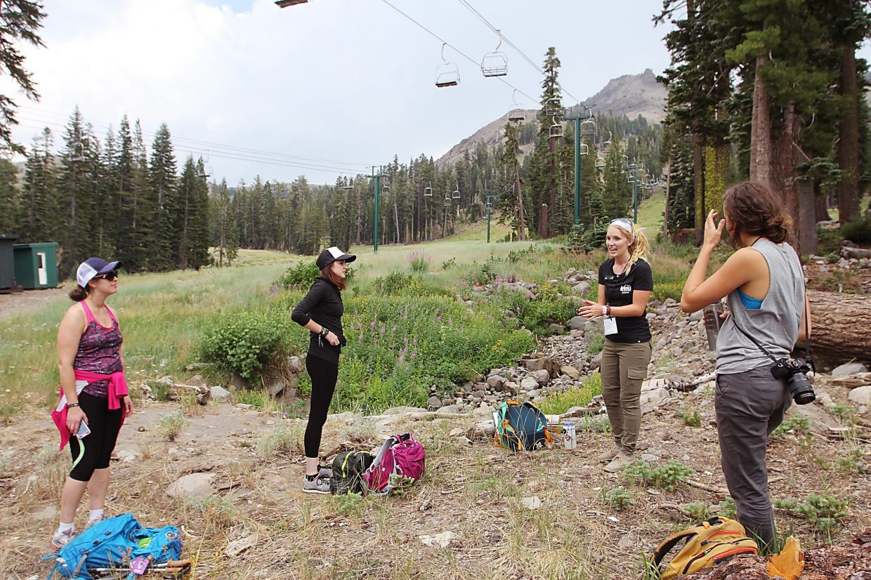 An REI Co-op instructor guides women on a hike in which they learn about wilderness survival skills, such as how to obtain clean water.