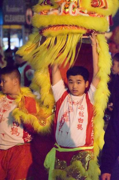 A parade participant lifts a dragon head during Chinese New Year festivities in San Francisco.