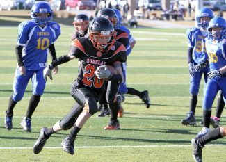 The Douglas Pee Wee Tigers take the ball against the South Tahoe Vikings Saturday during a Snow Bolw game at Golden Eagle Regional Park in Sparks.