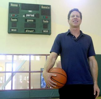 LTCC instructor Walter Morris poses for picture on the college's basketball court last week.