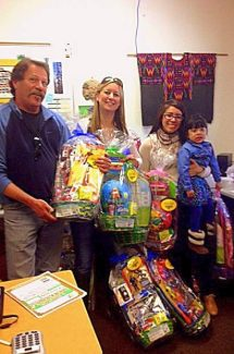 Community Service co-chairs Flip Walker and Jaime Souers, both from Pinnacle Real Estate Group of Lake Tahoe, deliver Easter baskets.