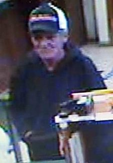 A surveillance still shows a suspect in an attempted robbery of El Dorado Savings Bank Thursday afternoon.