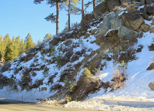 The boulder looks to have detached and rolled from a point roughly 20-25 feet uphill from the highway (pictured top right). NDOT officials credited the region's fluctuating temperatures for loosening the rock.