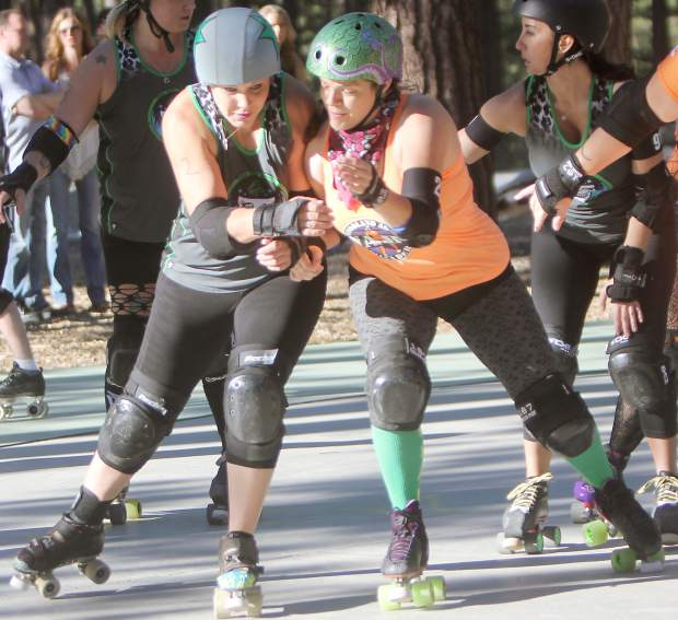 A Derby Dames skater jockeys for position with Woodland opposition Saturday.
