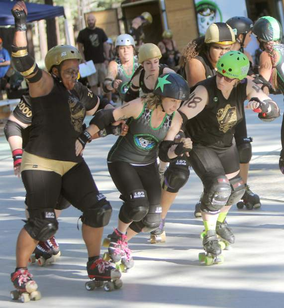 Tahoe's Di O'Brawlical slips past a pair of Carson blockers en route to becoming the lead jammer during a jam Saturday.