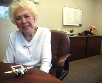 Betty McNeer with a model of the P-38 figher-bomber she worked on. Axie Navas / Tahoe Daily Tribune