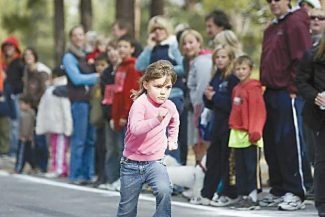 A participant in a previous Turkey Trot at Bijou Community Park is not short on determination.