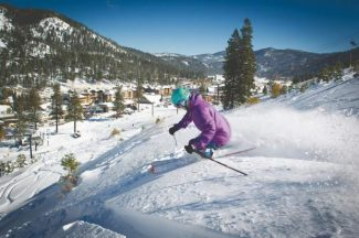 A skier rides through the powder at Squaw Valley. The National Ski Areas Association reported an 11 percent rise in skier and snowboarder visits this season. Courtesy Jeff Engerbretson / Tribune file photo
