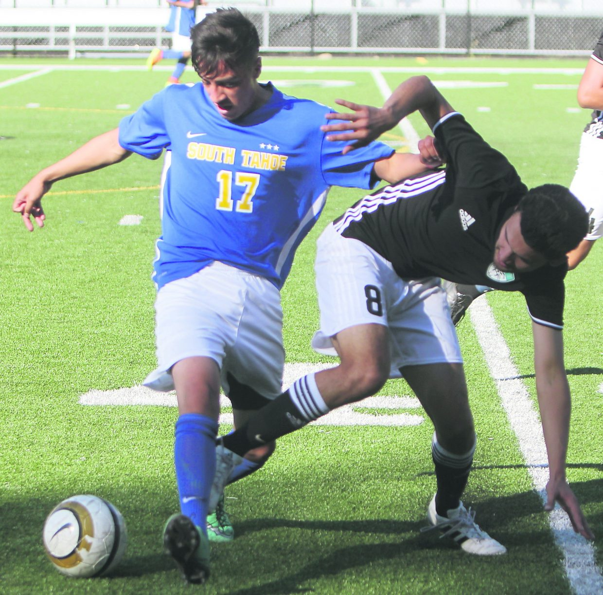 South Tahoe senior Gybran Martinez holds off a North Valleys defender during a non-league match Thursday, Aug. 25, at Viking Stadium.