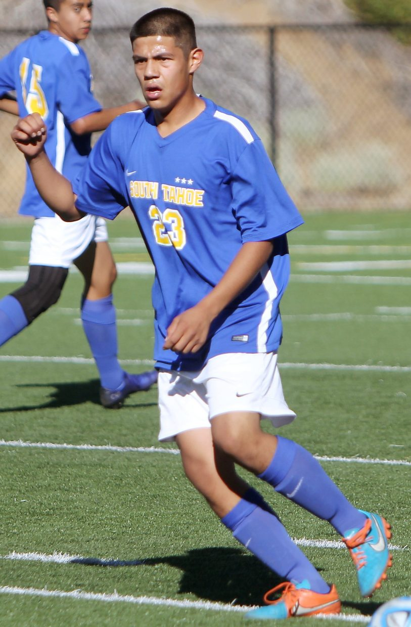 South Tahoe senior Armando Rosales gets in position to win back a loose ball Thursday.